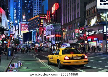 New York, Usa - July 1, 2013: People Visit Times Square In New York. Times Square Is One Of Most Rec