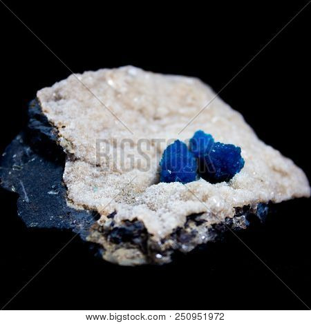 Natural Cluster Blue Cavansite On The Substrate On A Black Background