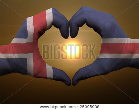 Heart And Love Gesture By Hands Colored In Iceland Flag During Beautiful Sunrise