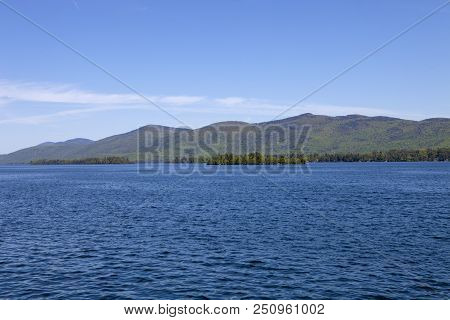 The Adirondack Mountains Rise In The Distance At Lake George
