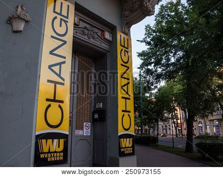 Szeged, Hungary - July 3, 2018: Western Union Logo On Their Main Exchange Office For Szeged. The Wes