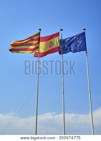 Flags Of Catalonia, Spain And European Union Waving.