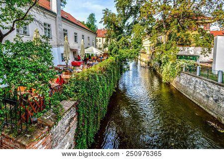 Prague, Czech Republic - September 27 2016: Tourists And Locals Eat Lunch At An Outdoor Cafe Alongsi