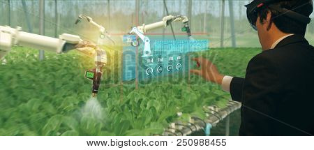 Iot Smart Industry Robot 4.0 Agriculture Concept,agronomist,farmer(blurred) Using Smart Glasses (aug
