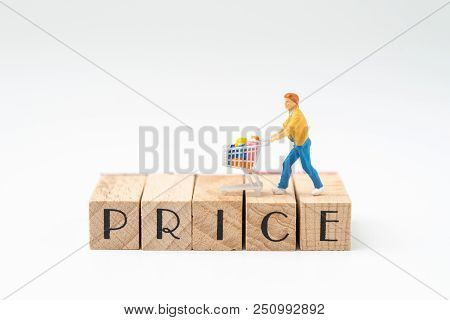 Promotion And Pricing For Marketing Commerce Concept, Miniature Figurine Trolly Shopping Cart With F