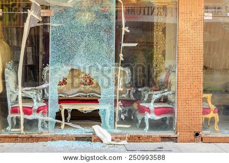 Broken window of a furniture shop in Fujeirah, UAE