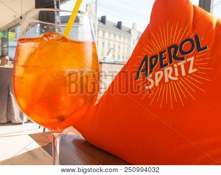 Moscow, Russia - July 18, 2018: Full glass of Aperol Spritz cocktail on the table in the restaurant. This drink is very poular this summer season