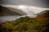 Dramatic storm with rain over the Loch Shiel Scotland poster