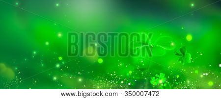 St. Patrick's Day green background decorated with shamrock leaves. Patrick Day pub party celebrating. Abstract Border art design, Magic nature backdrop. Widescreen clover art design with copy space