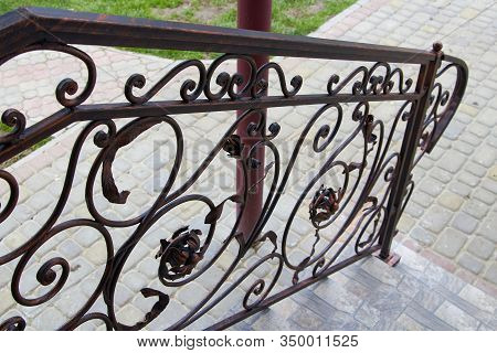 Metal Railing, View Down The Stairs Of Wrought Iron Railing