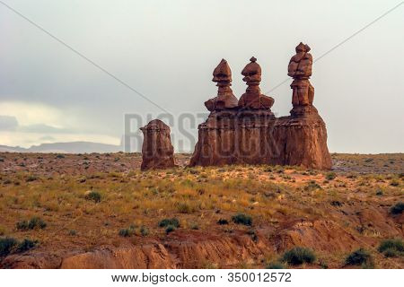 Hoodoo - geological formations. Original red brown sandstone formations resulting from erosion. Scenic Utah state park Goblin Valley. USA. The concept of active, ecological and photo tourism