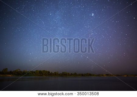 Stars On Dark Background. Summer Night Sky With Stars. Beautiful Natural Background. Mystical Landsc