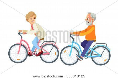 Happy Mature Couple Going Biking Together In The Park. Elderly Riding Bicycle. Couple Riding Bikes.