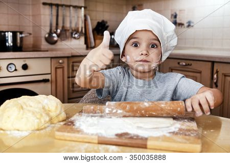 Little Kid Boy Helps Mother To Cook Pizza. Happy Family Mom And Child In Weekend Morning At Home. Pr