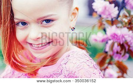 Cute Happy Joyful Girl With Long Hair Close Up. Springtime. Childhood. Funny Holliday. Cute Child Ha
