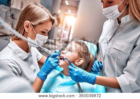 Young Blonde Girl At Dentist, Dental Treatment