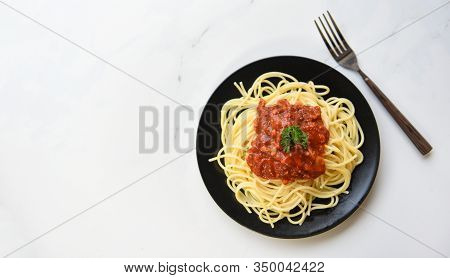 Spaghetti Bolognese , Top View / Spaghetti Italian Pasta Served On Black Plate With Tomato Sauce And