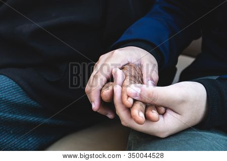 Relationship Support Of Family Mother Day Concept, Hands Of Asian Teenage Holding Elderly Grandmothe