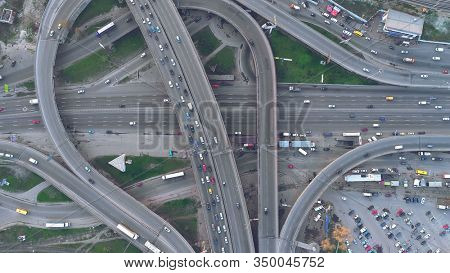 Top Down View Overpass Road Day Traffic in Kiev. Aerial Shot of Highway with Cars and Trucks. Drone Flight over Ukraine Capital Two Level Junction. Big City Sight
