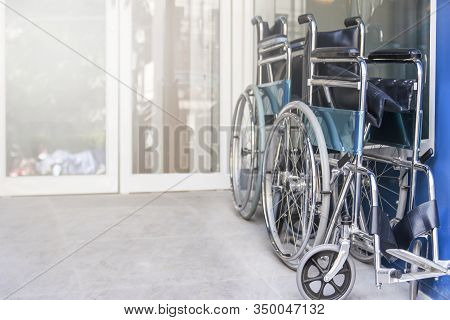 Wheelchair Are Fold And Park In The Hospital Entrance, Medical Equipment For Use As A Means Of Trans