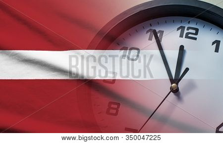 Composite Image Of The Latvia Flag And Clock