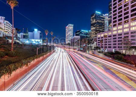 traffic on freeway through modern city at night in los angeles