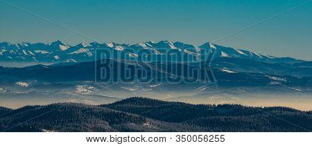 Western Part Of Vysoke Tatry And Whole Zapadne Tatry Mountain Range From Lysa Hora Hill In Winter Mo