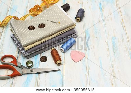 Sewing Tools And Fabric On A White Background. Concept For Needlework, Stiching, Embroidery And Tiol