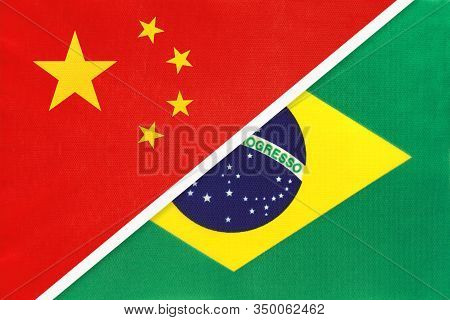 China Or Prc Vs Brazil National Flag From Textile. Relationship Between Asian And American Countries