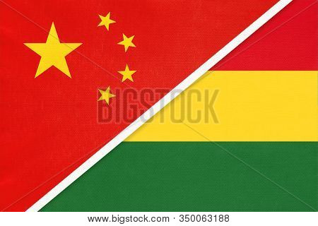 China Or Prc Vs Bolivia National Flag From Textile. Relationship Between Asian And American Countrie