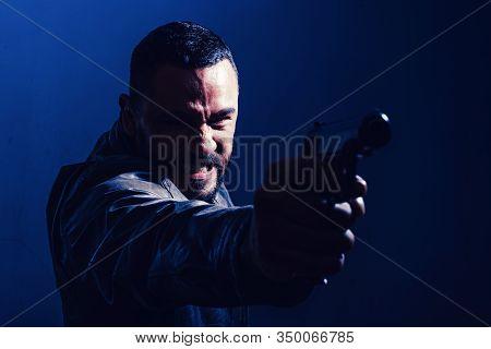 Killer Or Murderer Concept. Head Hunting. Man Handsome Mafia Killer Going To Shot Someone. Finish Hi