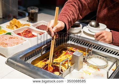 Chinese Hotpot Shabu Spicy And Sour Soup With Meat And Seafood, Suki Chinese Style - Selective Focus