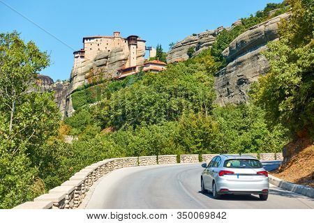 Car on the road to The Monastery of Rousanou in Meteora,  Greece