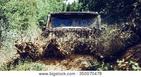 Off Road Sport Truck Between Mountains Landscape. Offroad Vehicle Coming Out Of A Mud Hole Hazard. D