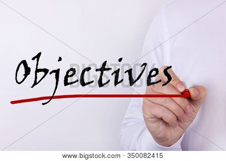 Hand Writing Objectives With Red Marker. Business, Technology, Internet Concept.