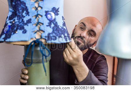 Fashion Designer Working On His New Creation. Beautiful  Blue Corset. Fashion Design Concept