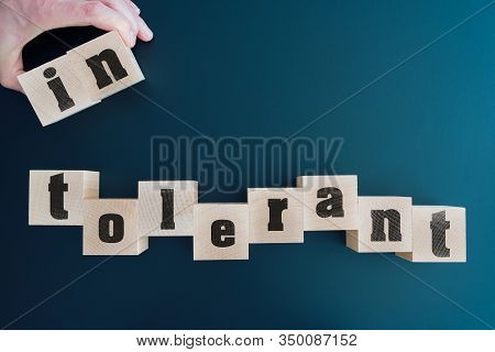 Top View Of Changing Word Intolerant To Tolerant On Wooden Blocks, Tolerance Concept