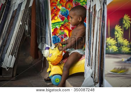 Dominican Child Plays In The Streets Of Dominicus