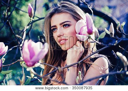 Magnolia. Sexy Blonde Woman With Perfect Makeup. Female Beauty Visage Concept. Girl In The Garden