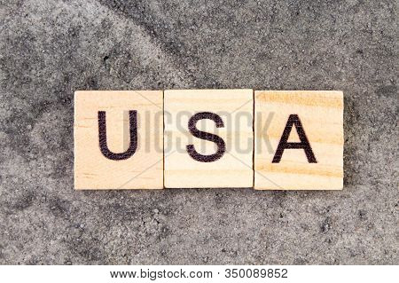 Usa Word Written On Wood Block, On Gray Concrete Background. Top View. United States Of America