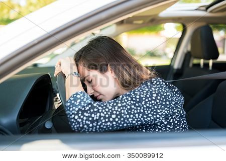 Frustrated Mid Adult Woman Waiting At Traffic While Sitting In Car