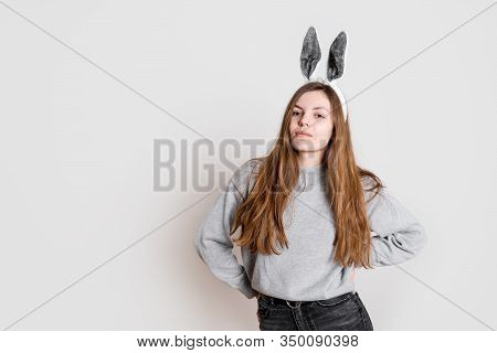 Teenager Girl Posing With Bunny Grey Ears On White Ackground. Easter Spring Season