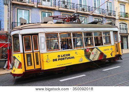 Lisbon, Portugal - June 6, 2018: People Ride The Yellow Tram In Chiado District, Lisbon, Portugal. L