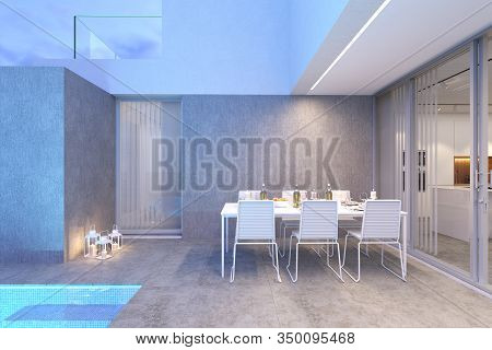 Exterior View Of Dinning Area On A Modern Architecture House Terrace In Grey And White Colours With