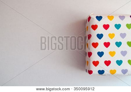 White Background With Box In Multicolored Hearts