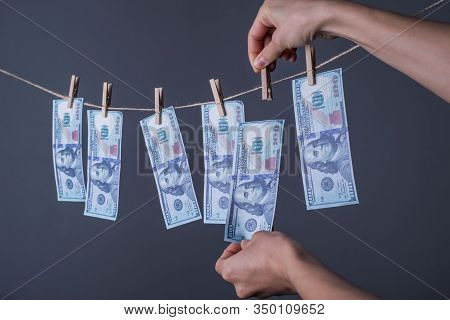 Close-up Of Money, Dried On The Ropes, Fastened With Clothespins. The Concept Of Drying Money. On A