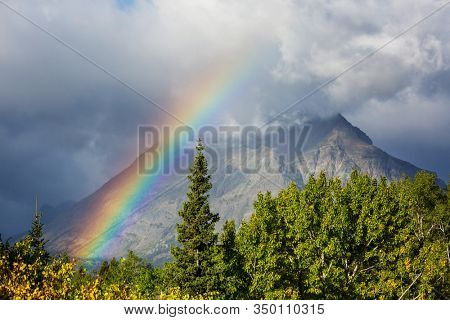 Rainbow above mountains. Beautiful natural landscapes. Picturesque nature.