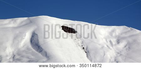 Trace Of Avalanche On Snowy Off-piste Slope. High Winter Mountains And Blue Clear Sky In Sunny Day.