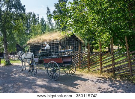 Oslo, Norway - July 19, 2018: Folkemuseum.white Horse With A 4-wheeled Cart On The Street Of The Old