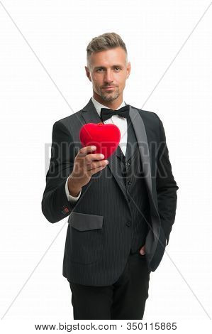 Generous Man. Man Mature Handsome Guy Wear Elegant Suit Hold Red Heart. Valentines Day Celebration.